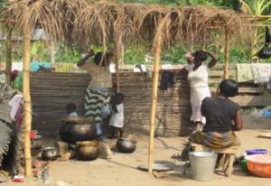 Women cooking outdoors