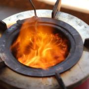 detail of burning mimi-moto cookstove