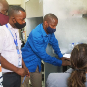 Sam Bentson trains Bernard Kabera and colleagues to use the new stove lab equipment