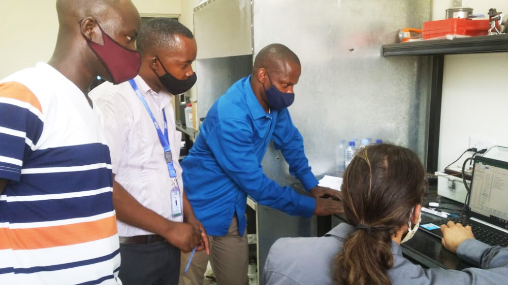 Sam Bentson trains Bernard Kibera and colleagues to use the new stove lab equipment